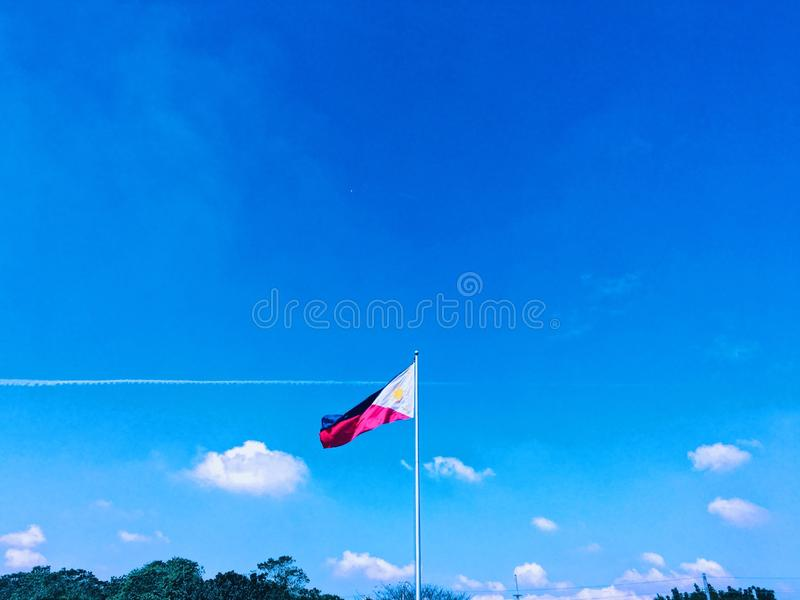 Philippine Flag. Philippine Flag with blue sky backgrounf royalty free stock images