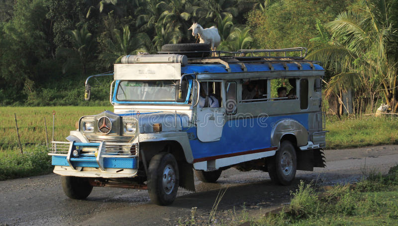 Philippine Jeepney. The Jeepney, a popular mode of transport in the Philippines. It was made from the original miiltary jeeps of World War II. Filipino craftsmen stock photo