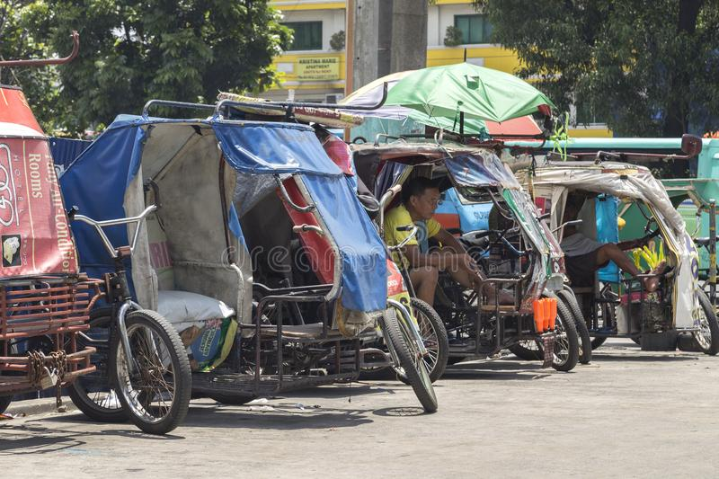 Philippine tricycles on the street stock photos
