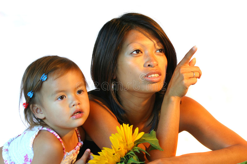 Philippine woman with child. Attractive philippine woman with her child pointing at something
