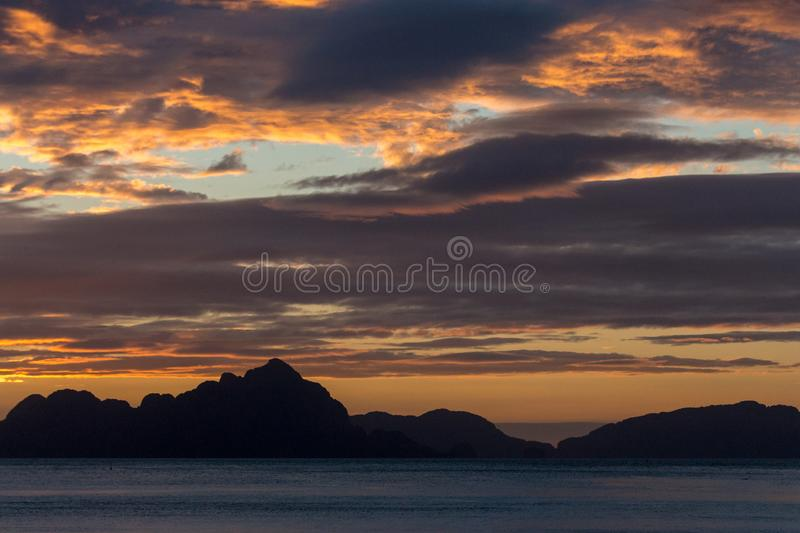 Philippines isles at sunset. Scenic sunset above sea. Travel and summer vacation concept. Island silhouette in evening dusk. Calm evening on tropical coast royalty free stock photo