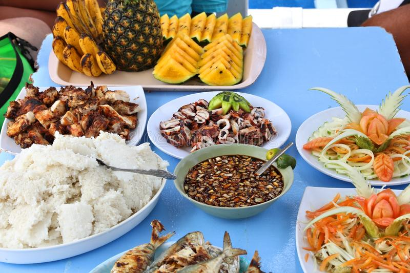 Philippines lunch food. Meat, rice, fruit and seafood lunch in Philippines boat tour royalty free stock photos