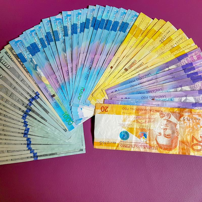 Philippines Peso and US Dollars stock photography