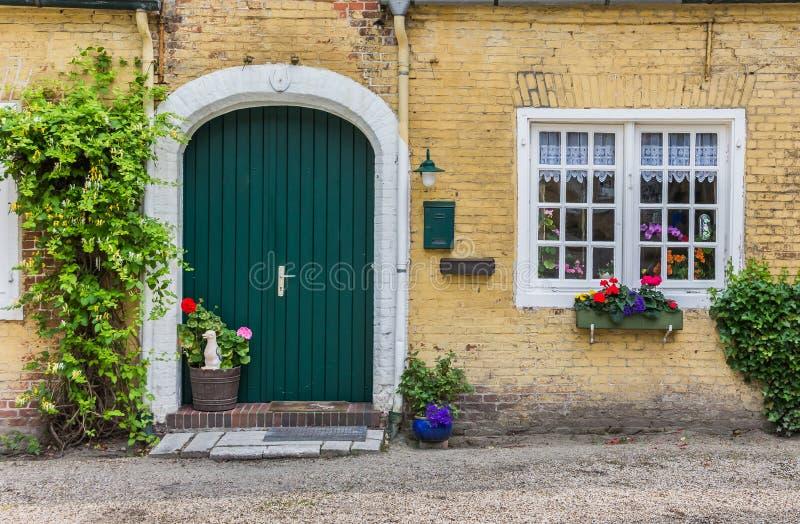 Philippsburg in Leer, Germany. Green door of the Philippsburg in Leer, Germany royalty free stock images