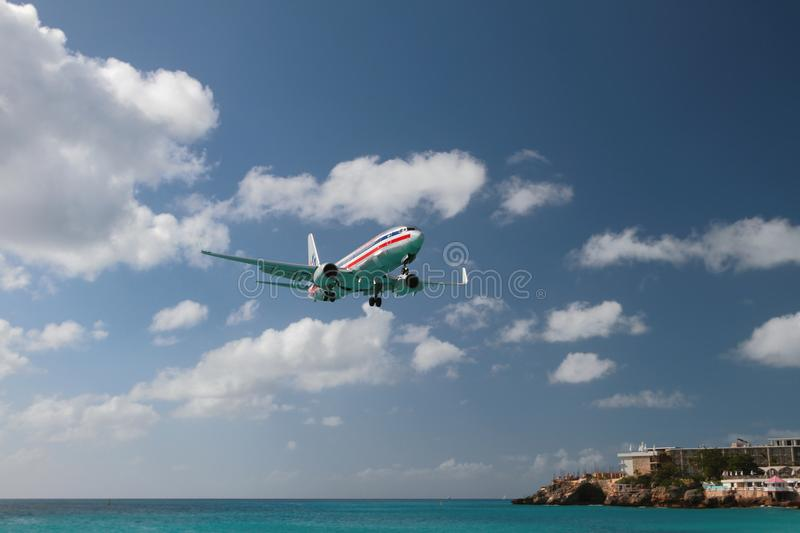 Philipsburg, Saint-Martin - Jan 05, 2015: Passenger airliner carries out landing to tropical island stock images