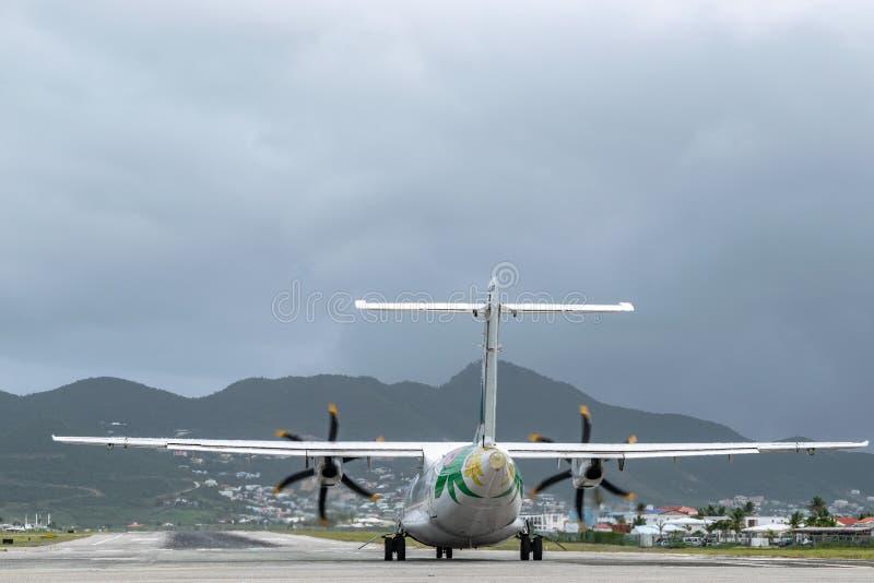 Air Antilles medium twin turbo-prop regional aircraft ATR 42-500 on runway royalty free stock photo