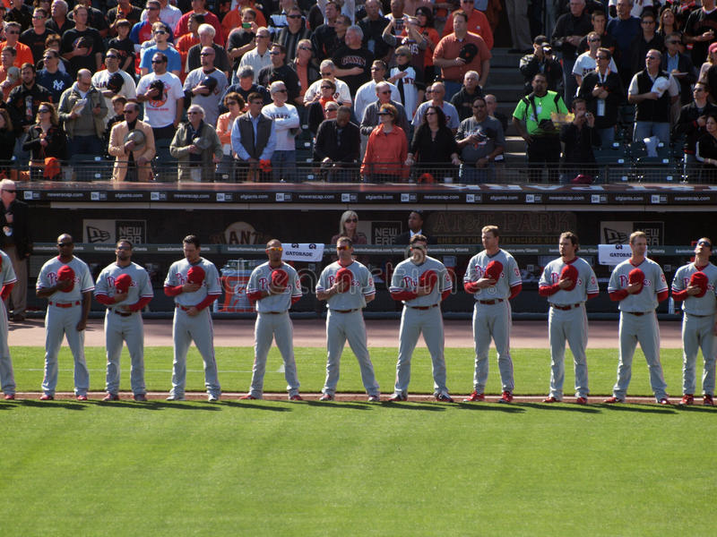 Phillies Players Stand In A Line With Hats Removed Editorial Image