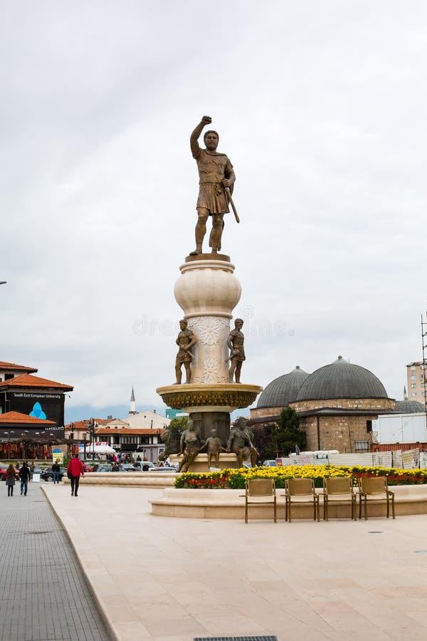Phillip II of Macedon statue and Daut Pasha Hamam. Skopje, Macedonia - September, 30, 2015: Phillip II of Macedon statue and Daut Pasha Hamam domes royalty free stock photography