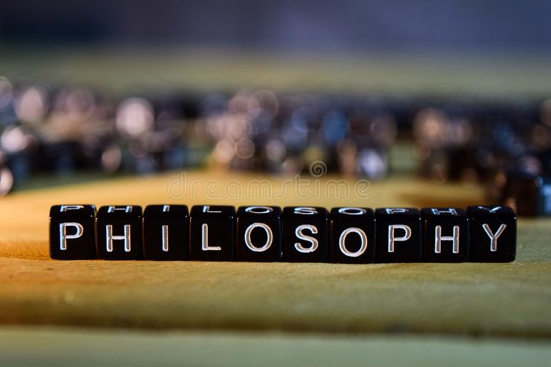 PHILOSOPHY concept wooden blocks on the table. With personal development, education and motivation concept on blurred background royalty free stock photos