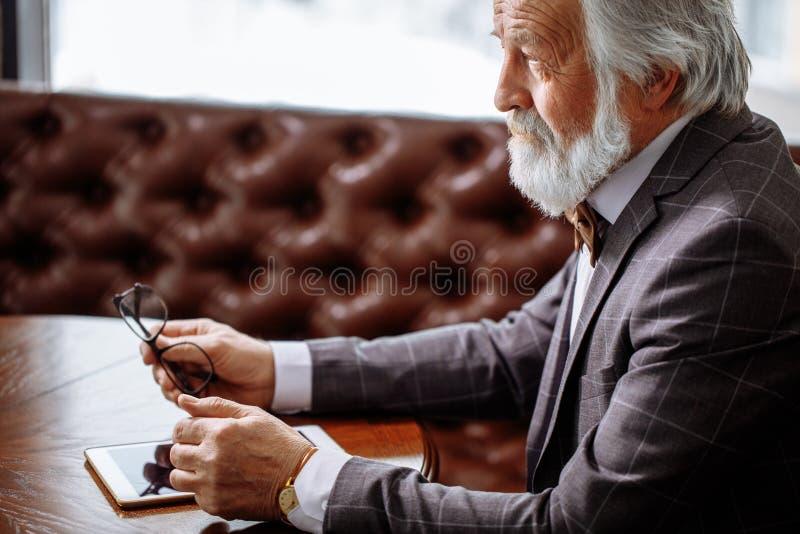 Philosophy of life. philosophizing old man royalty free stock photos