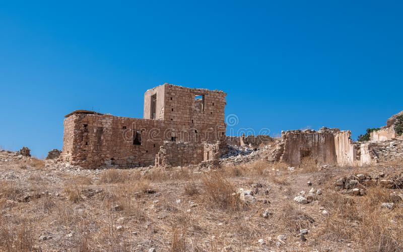 Phinikas is a Deserted Island in Paphos District, Cyprus. Phinikas is a deserted village in paphos district. It was evacuated after the Turkish invasion of royalty free stock photo