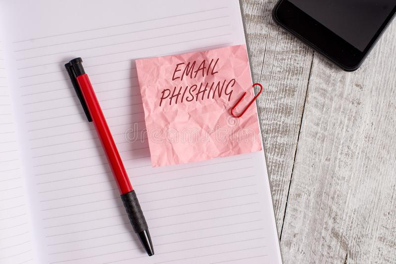 Phishing conceptual del correo electr?nico de la demostraci?n de la escritura de la mano Correos electrónicos del texto de la fot imágenes de archivo libres de regalías