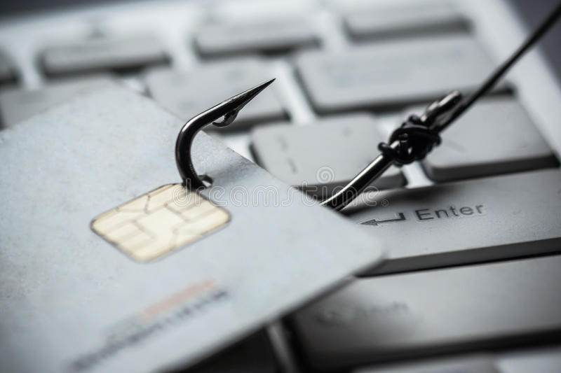 Phishing. Credit card phishing attack / credit card with a hook on keyboard royalty free stock photos
