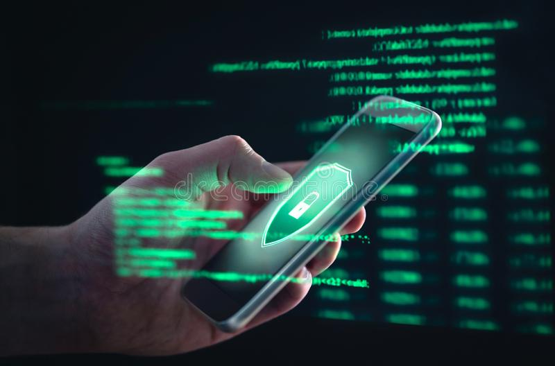 Phishing, cyber security, online information breach or identity theft crime concept. Hacked phone. Hacker and cellphone with hologram data. Mobile scam, fraud royalty free stock images