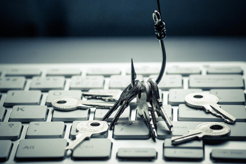 Phishing. A fish hook with keys on computer circuit board / phishing / computer data theft concept royalty free stock images