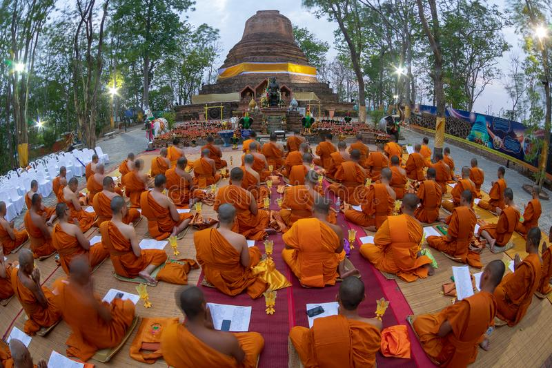Phitsanulok Province, Thailand-2019 May, Many Buddhism sit down on big pagoda and Signal King Narasuan ,They are pray. And concentration in Vesak day, and stock photo