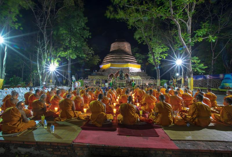 Phitsanulok Province, Thailand-2019 May, Many Buddhism sit down on big pagoda and Signal King Narasuan ,They are pray. And concentration in Vesak day, and stock photography