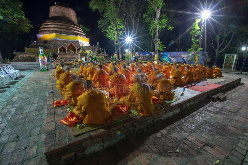 Phitsanulok Province, Thailand-2019 May, Many Buddhism sit down on big pagoda and Signal King Narasuan ,They are pray. And concentration in Vesak day, and royalty free stock image