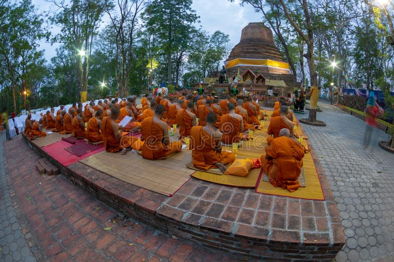 Phitsanulok Province, Thailand-2019 May, Many Buddhism sit down on big pagoda and Signal King Narasuan ,They are pray. And concentration in Vesak day, and royalty free stock photography