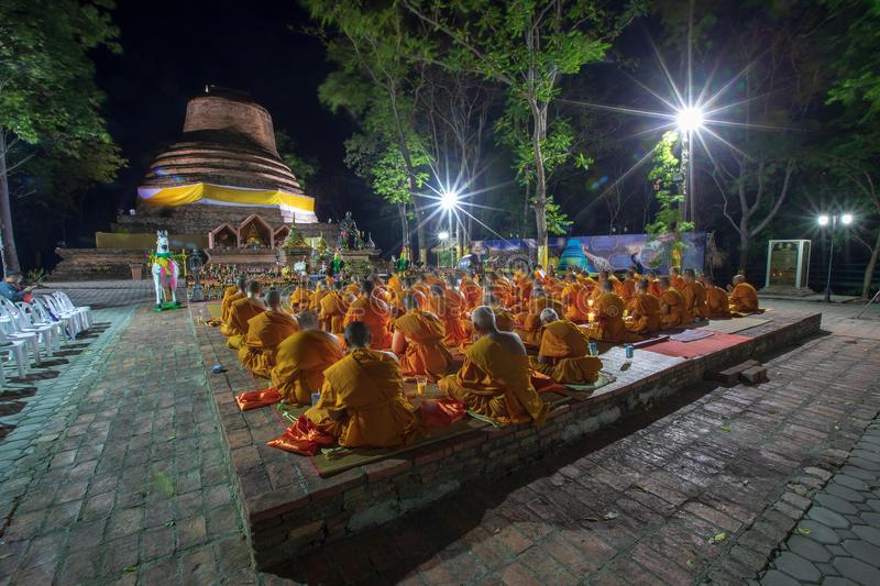 Phitsanulok Province, Thailand-2019 May, Many Buddhism sit down on big pagoda and Signal King Narasuan ,They are pray. And concentration in Vesak day, and stock images