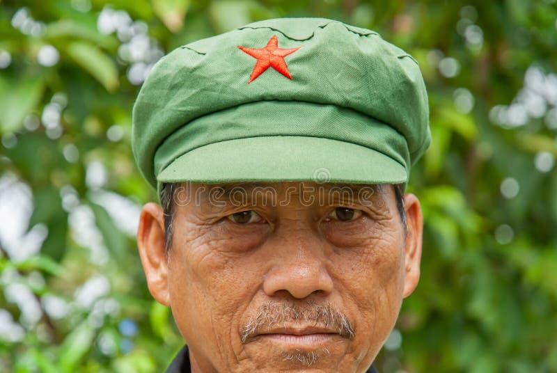 Hmong tribe senior man wearing a Mao style cap stock photography