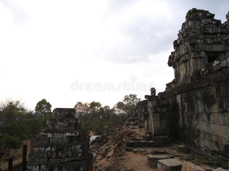 Phnom Bakheng, Angkor, at year 2008, before restoration work begins. Siem Reap,Cambodia-March 9, 2008: Phnom Bakheng, Angkor, at year 2008, before restoration royalty free stock photo