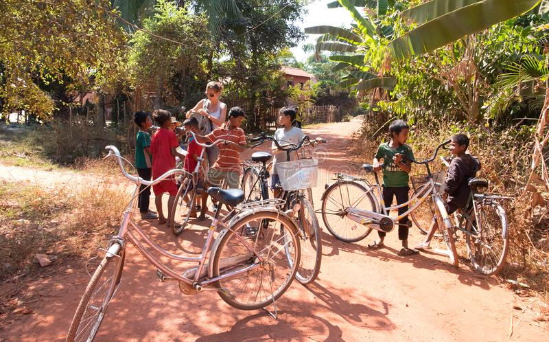 Cambodian children. PHNOM PENH, CAMBODIA - JANUARY 05 2015: Cambodian children are students going to classes at the school on bicycles royalty free stock photos