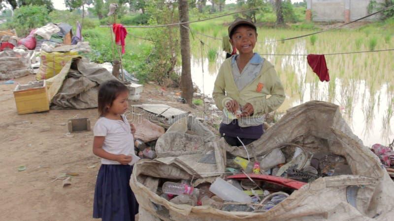 Cambodian Kids In Slums Near Phnom Penh City Dumping Area
