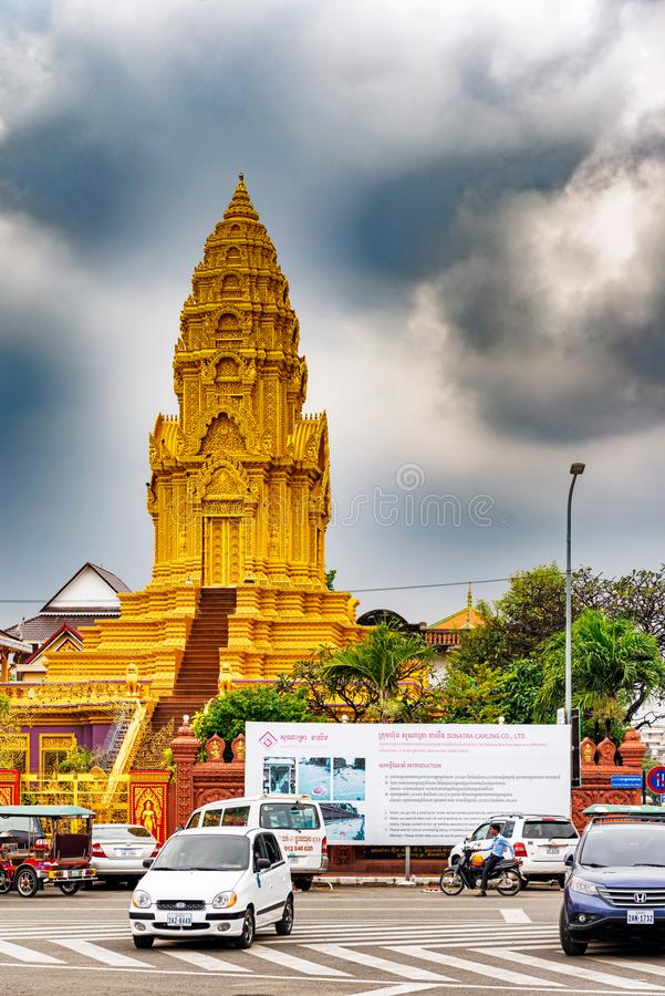 Wat Ounalom temple, Phnom Penh, Cambodia. Phnom Penh, Cambodia - November 14, 2017: Traffic on the street in front of 15th century Buddhist temple called Wat royalty free stock images