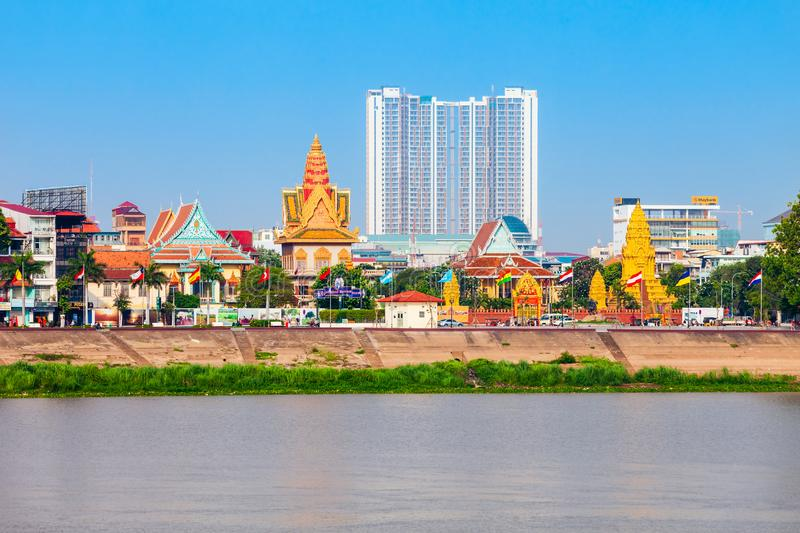 Phnom Penh city skyline, Cambodia. PHNOM PENH, CAMBODIA - MARCH 24, 2018: Phnom Penh city skyline and Tonle Sap River royalty free stock photography