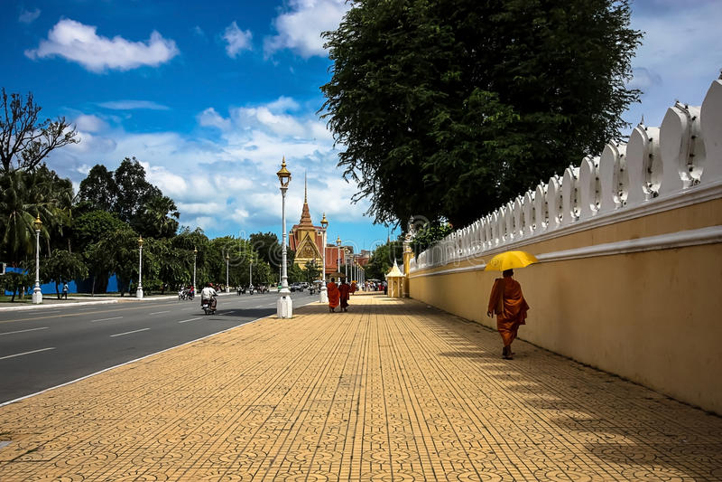 Phnom Penh. A monk walking on the streets of Phnom Penh, Cambodia stock photos