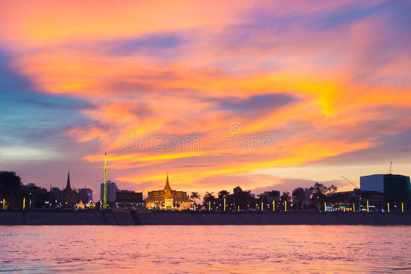 Phnom Penh skyline at sunset capital city of Cambodia kingdom, panorama silhouette view  from Mekong river, travel destination,. Dramatic sky stock photography