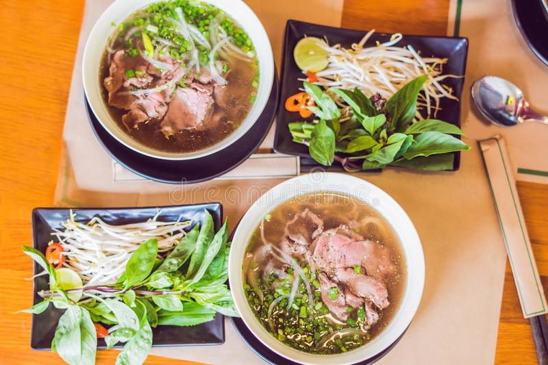 Pho Bo - Vietnamese fresh rice noodle soup with beef, herbs and chili. Vietnam`s national dish royalty free stock image