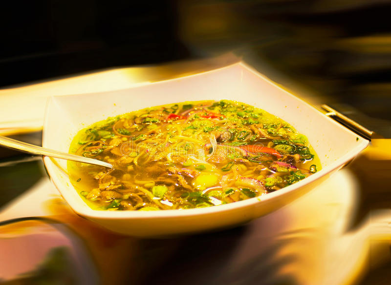 Pho Vietnamese soup. Pho traditional Vietnamese soup close up with all ingredients on blurred background stock photography