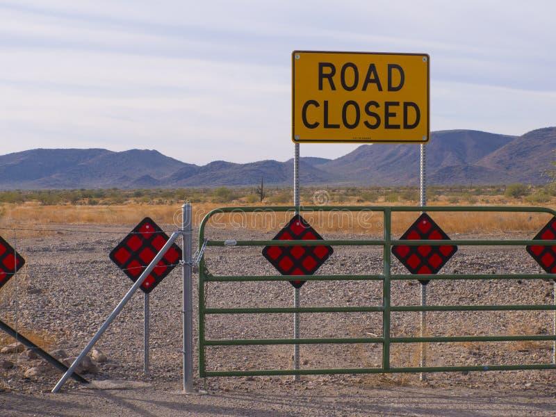 Phoenix Arizona Desert Road Closed Tight Shot. Phoenix Arizona Desert Road Closed Sign with beautiful open desert and mountain background stock images
