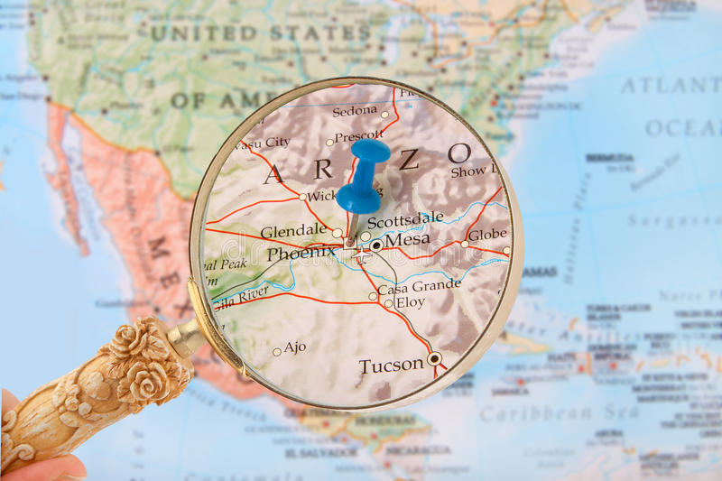 Phoenix, Arizona, USA. Blue tack on map of United States of America with magnifying glass looking in on Phoenix, Arizona stock image