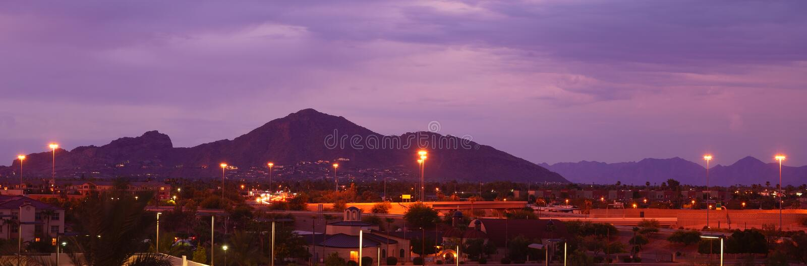 Phoenix, Arizona, USA cityscape at night with famous Camelback Mountain. Phoenix, Arizona, metropolitan area in beautiful colors at dusk with prominent landmark royalty free stock images