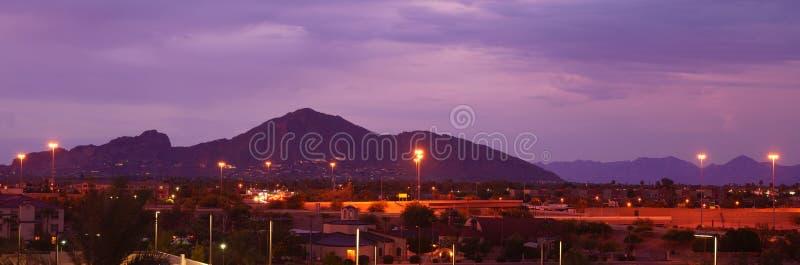 Phoenix, Arizona, USA cityscape at night with famous Camelback Mountain. royalty free stock images