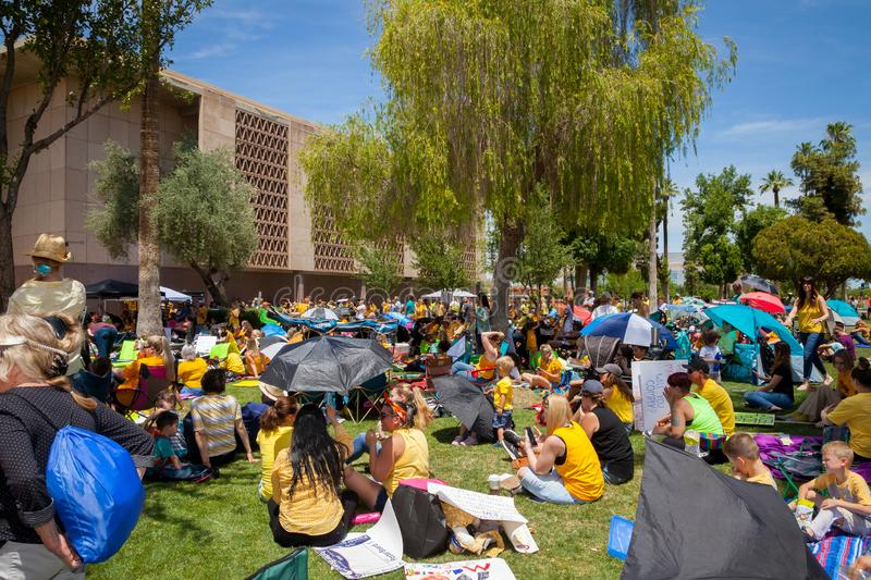 PHOENIX, ARIZONA-USA – MAY 18, 2019- Crowd at the Arizona March for Medical Freedom. Sitting on the AZ State Capitol lawn stock photos