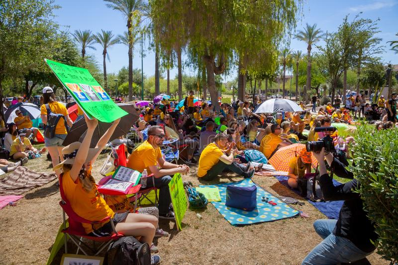 PHOENIX, ARIZONA-USA – MAY 18, 2019- Crowd with signs at the Arizona March for Medical Freedom. Sitting on the AZ State Capitol lawn stock images