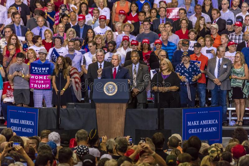 PHOENIX, AZ - AUGUST 22: U.S. Vice President Mike Pence, flanked by Frankin Graham (L) and Ben. Donald Trump, Civics. PHOENIX, AZ - AUGUST 22: U.S. Vice royalty free stock images