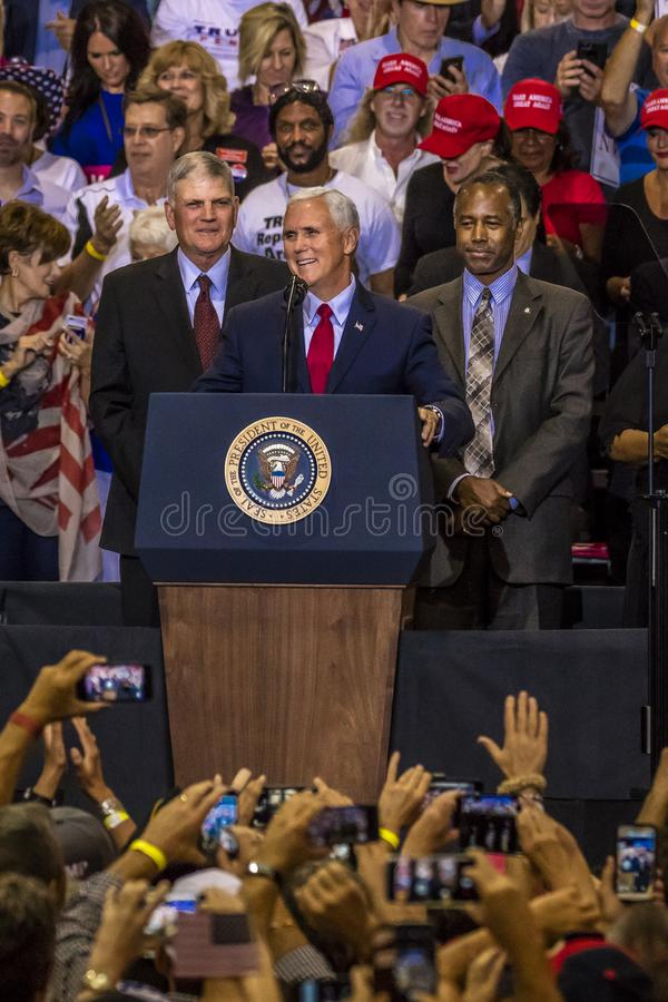 PHOENIX, AZ - AUGUST 22: U.S. Vice President Mike Pence, flanked by Frankin Graham (L) and Ben. US Flag, Ben Carson. PHOENIX, AZ - AUGUST 22: U.S. Vice President stock image