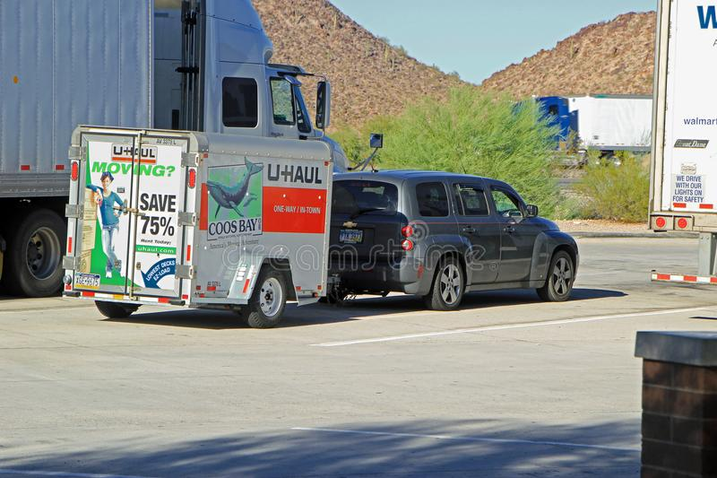 Moving truck parked off highway in Phoenix Arizona. PHOENIX AZ - OCTOBER 04 2013: A truck with an U-Haul trailer parked on a roadside stop off the highway in royalty free stock photo