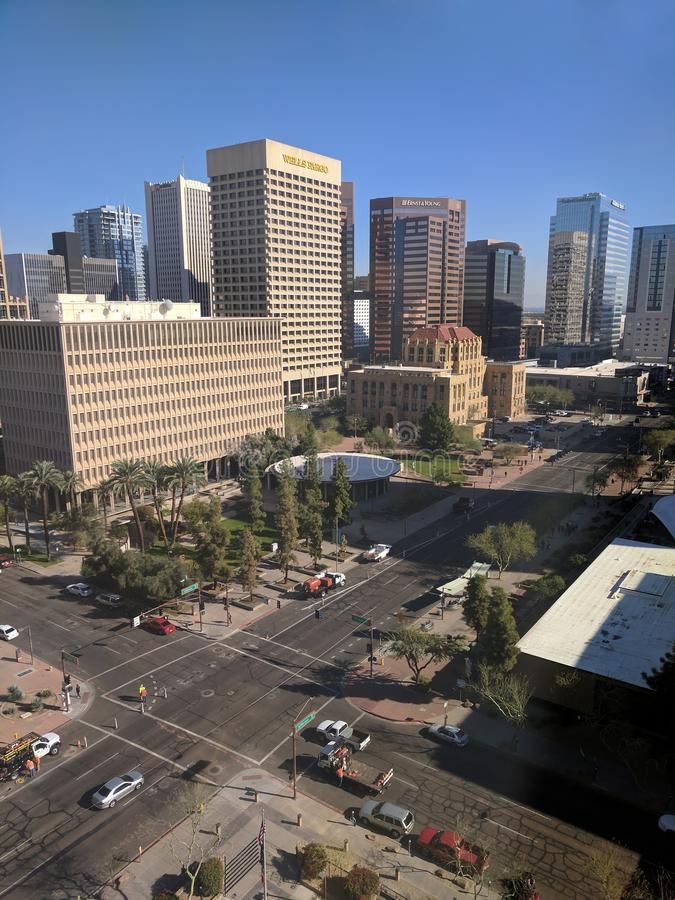 Phoenix Downtown, AZ. PHOENIX, AZ, USA - JANUARY 11, 2018: Sunny winter day and clear blue sky above 3rd Avenue and Jefferson intersection in Phoenix downtown royalty free stock photos