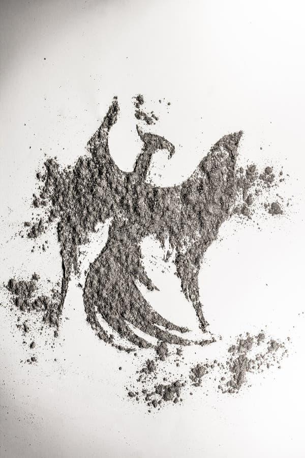 Phoenix, eagle bird drawing in ash as life, death symbol royalty free stock photos