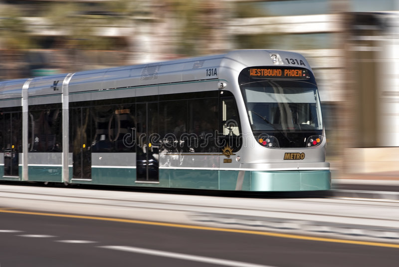 Phoenix Light Rail Moving Train. Phoenix opened its new $1.4 billion 20-mile light rail system. The Metro Light Rail connects Phoenix, Tempe and Mesa. Businesses royalty free stock image