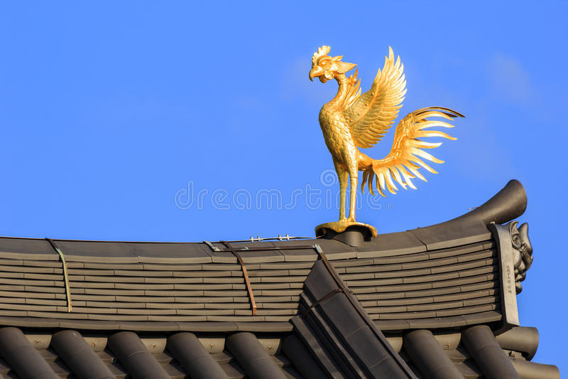 Phoenix Ornamaent on the Roof of Byodo-in Temple in Kyoto stock images