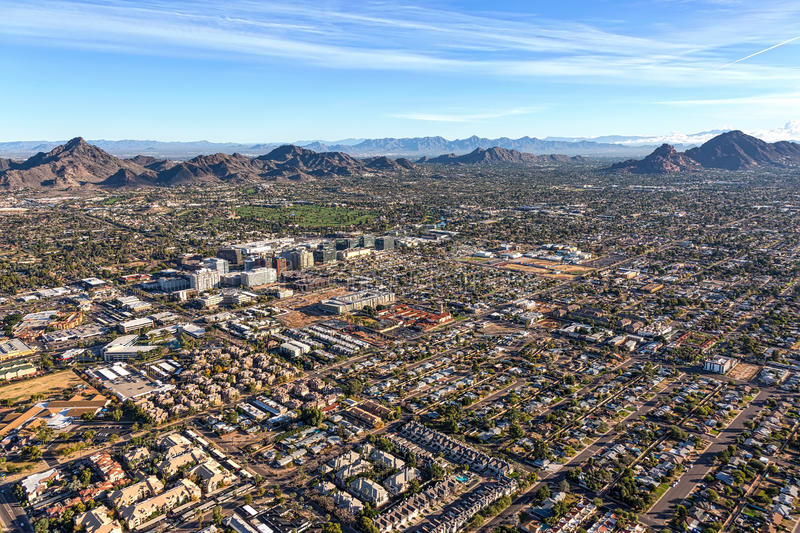 Phoenix Rising. Morning sun on the desert landscape of Phoenix, Arizona near the Camelback corridor viewed from above stock photography