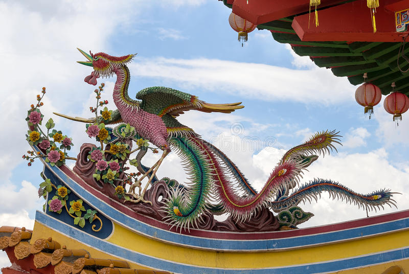 Phoenix Sculpture on Chinese Temple Roof. Phoenix Bird Sculpture on Chinese Temple Roof Top in Southeast Asia royalty free stock photo