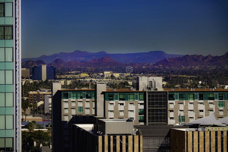 Downtown Phoenix skyline with mountains. Downtown Phoenix Arizona building skyline with mountain range in the distance royalty free stock photography
